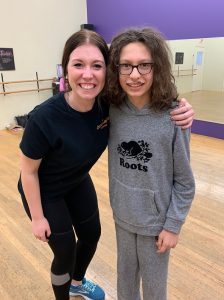 Becca posing with a dancer in class